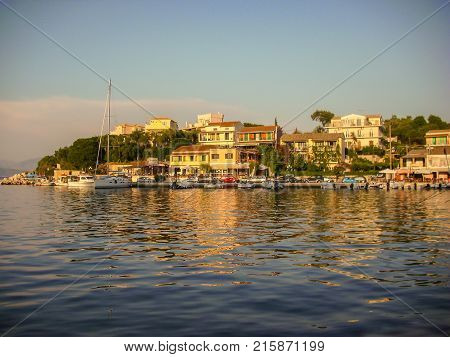 Kassiopi Corfu Greece - June 07 2013 : Beautiful sunset of boat docking area in Kassiopi Corfu Greece