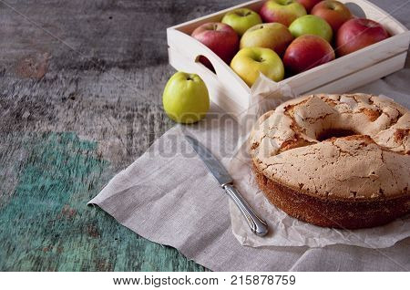 Apple pie with a cup of tea on a wooden background. Apple pie Apples Cup of tea Piece of cake Wooden background Delicious dessert