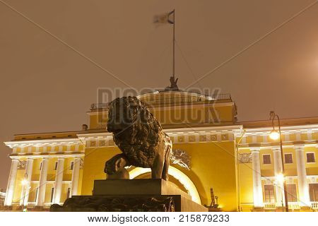 Night St. Petersburg, Russia. Lion sculpture on a background oriental pavilion of the Admiralty