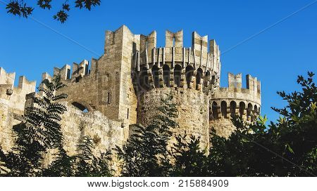 The Palace of the Grand Master of the Knights of Rhodes close-up view. Rhodes Greece. A part of medieval wall surrounding the old town Rhodes. Historical fortifications castle tower