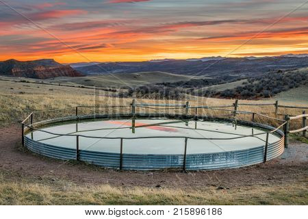 cattle water tank in Colorado mountain ranch - Red Mountain Open Space near Fort Collins, sunset scenery