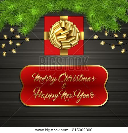 red square gift box with gold ribbon bow garland on black wooden board greeting text merry chrismas and happy new year on red label with