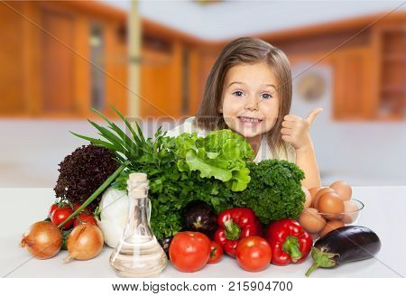 Girl little vegetables healthy eating elementary age child care preadolescent child