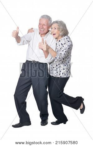 Senior couple smiling with thumbs up isolated  on white background