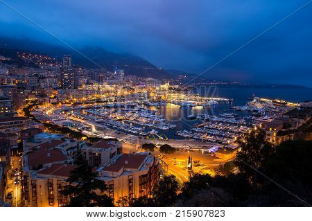 Cityscape of La Condamine at night Monte Carlo Monaco. Principality of Monaco French Riviera