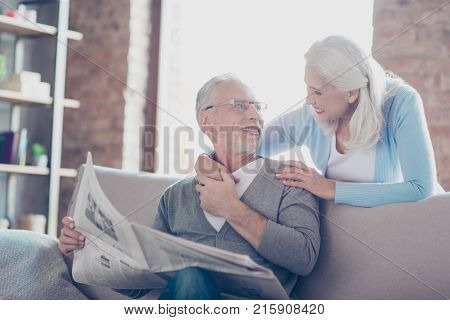 So Lovely And Tender Old Couple! A Grandfather Is Reading A Newspaper And Telling The Latest News To