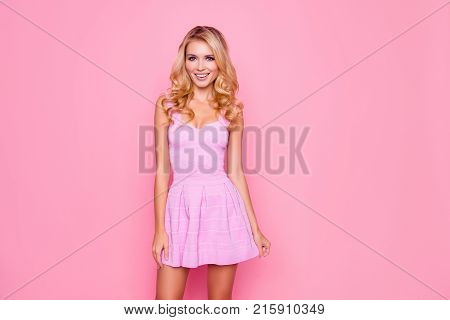 Portrait Of Attractive, Beautiful, Caucasian, Positive Girl In Cocktail Dress, Holding The Bottom Of