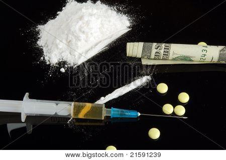 Drug. Cocaine, Money, Syringe And Tablet.