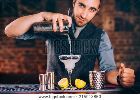 Portrait Of Handsome Bartender Using Bar Tools For Alcoholic Cocktails. Margarita With Tequila, Slic