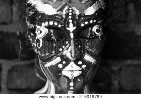 Close-up Portrait of an attractive young girl in bright blacklight bodyart monochrome