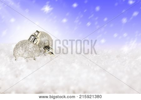 xmas baubles on snow with copy space