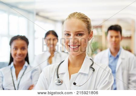 Woman as successful and friendly doctor with hospital staff