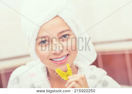 Teenage Girl In Bathroom With Dental Retainer Braces. Morning And Evening Dental Hygiene