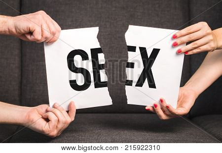 Sex problems impotence or sexually transmitted disease concept. Couple man and woman ripping the same paper.