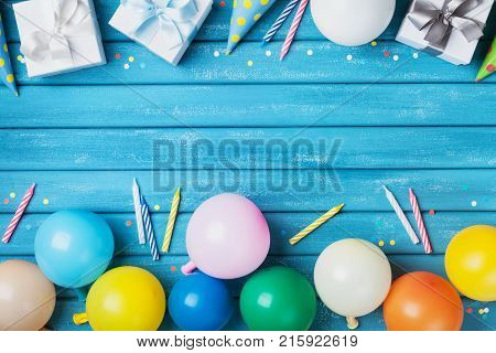 Party birthday banner or background with balloons gift carnival cap confetti and candle. Copy space for greeting text.