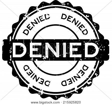 Grunge black denied wording round rubber seal stamp on white background