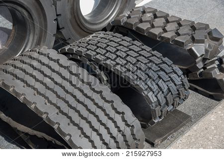 Several car black rubber tires on sale with different tread pattern and different sizes for trucks and cars