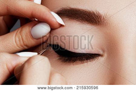 Makeup Artist Applies Eye Makeup. Close-up Macro Of Beautiful Eye With Perfect Shape Eyebrows. Beaut