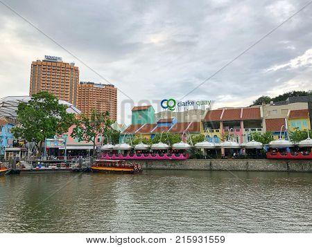CLARKE QUAY SINGAPORE - 28 NOV 2017: Sightseeing boat in Clarke Quay, Singapore river