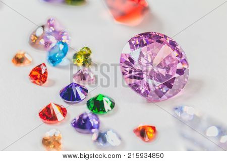 Colorful Gemstones Are Displayed On The White Floor