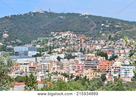 Spain. Top-view of Barcelona and Tibidabo mountain in a sunny summer day