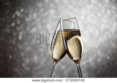 Festive photo of two wine glasses with sparkling champagne