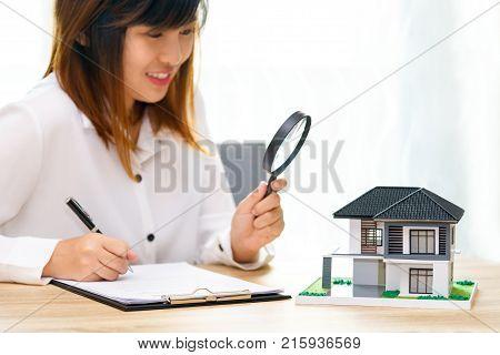 Smile woman searching for new home or inspecting homes before buying concept