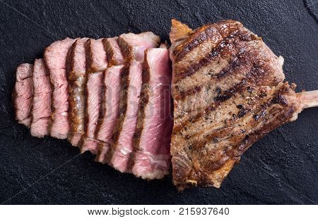 Grilled tomahawk steak beef With rosemary . Food background