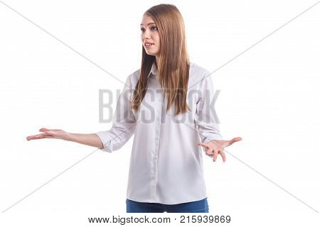 Young girl in a white shirt than is distressed looking away and holding her hands on a white isolated background