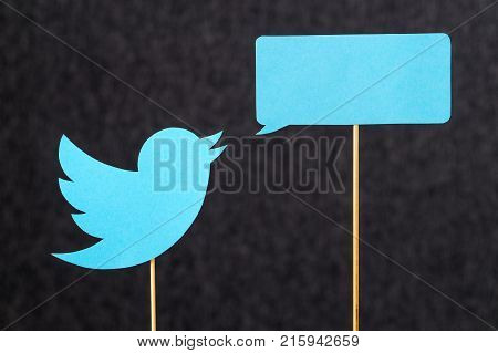 JYVASKYLA FINLAND - JULY 2 2017: Twitter logo and speech balloon cut from cardboard against dark background. Twitter is a social media network that was founded in 2006. Illustrative editorial.