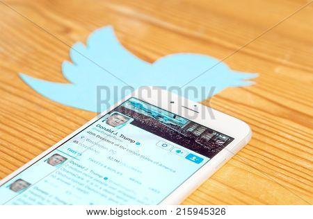 JYVASKYLA FINLAND - JUNE 13 2017: The official Twitter account of Donald Trump on mobile phone screen and printed bird logo. The American President is an active Twitter user. Illustrative editorial.