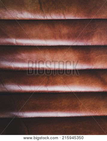 Luxurious Red - tone leather texture furniture .