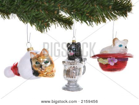 Cats Christmas ornaments on a tree over white poster