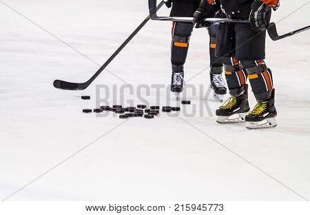 some ice hockey players playind on ice