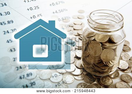 symbol of the house and a bunch of Russian coins and a glass jar