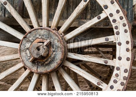 Close up of a Ming Dynasty wooden wheel on a horse cart.
