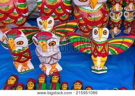 Colorful owls made of wood. Handicrafts on display during the Handicraft Fair in Kolkata earlier Calcutta West Bengal India. It is the biggest handicrafts fair in Asia.
