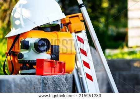 Measuring geodetic level and a theodolite at construction site