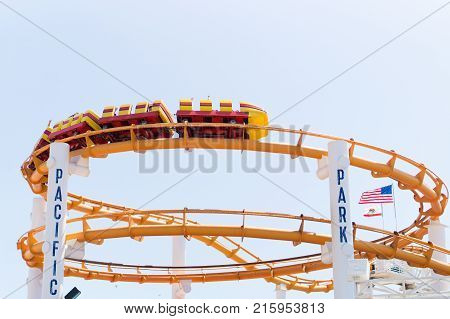 LOS ANGELES USA - AUGUST 18 2017: The roller coaster in Pacific Park amusement park on the Santa Monica Pier. Editorial.