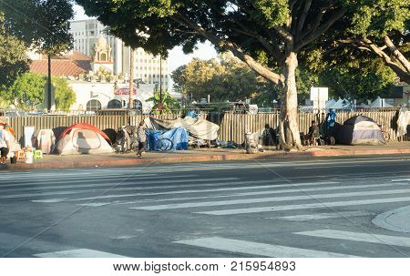 LOS ANGELES USA - AUGUST 28 2017: A row of tents and things of homeless people in Downtown LA. There are over 30 000 homeless living in the city of Los Angeles. Editorial.