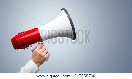 Human hand megaphone one person close up young adult business person