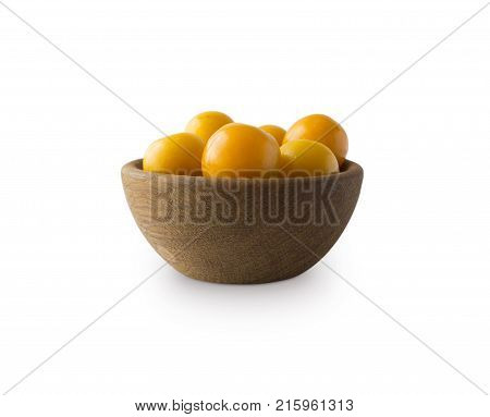 Bowl with yellow plums (cherry-plum) isolated on white background. Ripe plums with copy space for text.