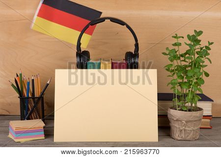 The Concept Of Learning German Language - Blank Paper Flag Of The Germany Books Headphones Pencils O
