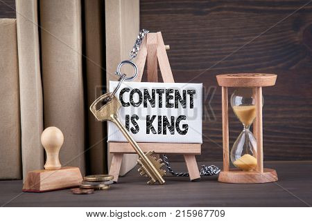 content is king concept. Sandglass, hourglass or egg timer on wooden table showing the last second or last minute or time out