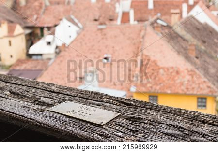 Sighisoara Romania October 08 2017 : Pointer - Praga (Prague) 864 Km - nailed to the railing of the Clock Tower in the castle of old city. Sighisoara city in Romania