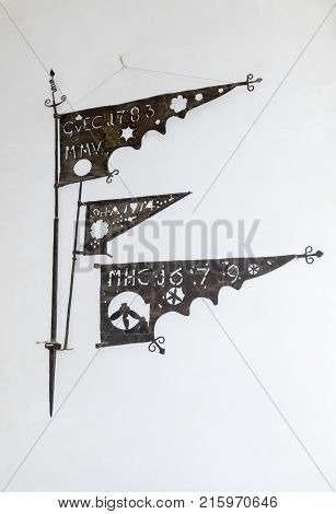Sighisoara Romania October 08 2017 : Remnants of metal flags used in a tower 17-18 century attached to the wall of the Clock Tower to the old city. Sighisoara city in Romania