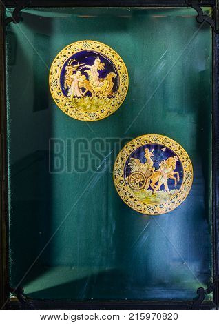 Sighisoara Romania October 08 2017 : Commemorative medals in a glass niche set for general view in the Clock Tower to the old city. Sighisoara city in Romania