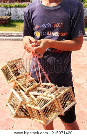 Vientiane, Laos - November 29: An Unidentified Man Sells Birds Near Pha That Luang On November 29, 2