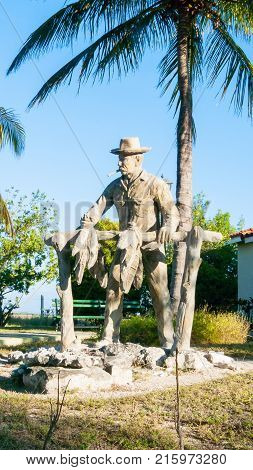 February 2012 Cayo Largo Island Cuba This is a close up of one of a wooden sculpture built in a courtyard of Cuba in honor of tobacco farmers that tourist can admire in this sunny day.