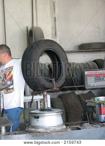 Man Working On A Flat Tire
